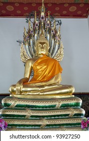 Golden Buddha surrounded by serpents Bangkok Thailand