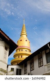 golden Buddhist Temple against blue sky