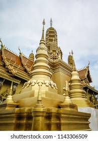 Golden buddhist temple with stupa, replica of an ancient thai temple in Ancient City at Muang Boran in Thailand, Buddhavas of the Substanceless Universe