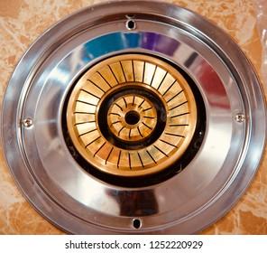 Golden burners of a gas stove unique photo