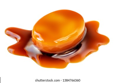 Golden Butterscotch toffee candy caramel with flowing sauce on a top. Sweet treat  isolated on a white background, macro.