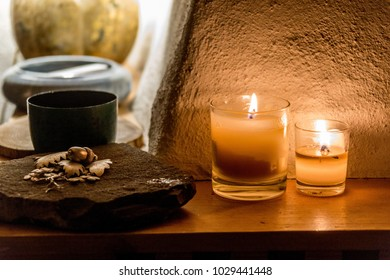 Golden Candles and Decoration on Stone