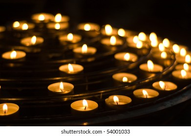 Golden candles on black background