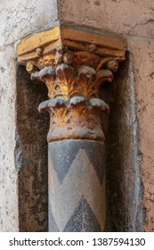 Golden capital of a small decorative pillar (column) with engraved floral inscriptions at the ancient public mosque of Sultan Hassan, Old Cairo, Egypt