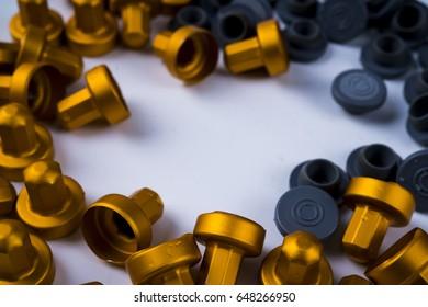 Golden caps as a background concept./ golden caps.