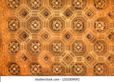 Golden ceiling with fleur-de-lys inside 14th century Palazzo Vecchio, Florence. Medieval architecture of Italy.