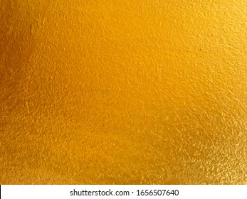 Golden cement wall surface texture background