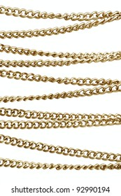 Golden chain in arrangement,  isolated against white background
