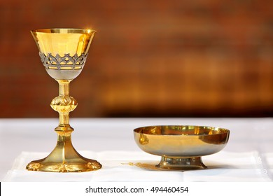 Golden chalice on the altar during the mass and place for text