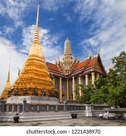 Golden Chedis and Royal Pantheon at Wat Phra Kaew, Bangkok, Thailand.