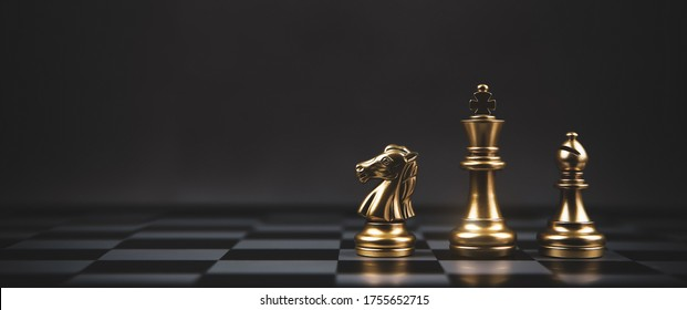 Golden chess team on chess board Concept of business strategic plan and professional teamwork and risk management.