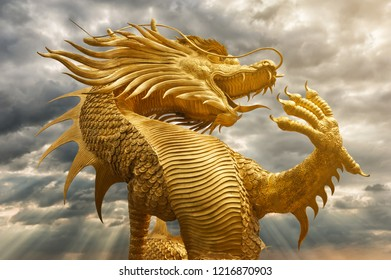 Golden Chinese dragon with sunset