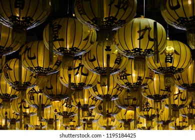 Golden Chinese lanterns,selective focus,Chinese characters refer to vegetarian festivals,Nine Emperor Gods Festival.