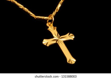 golden christian crosses with chain isolated on black background