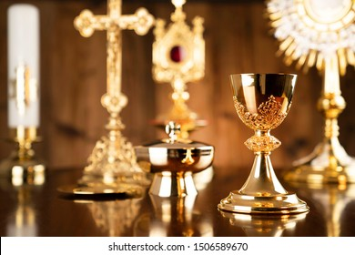 Golden Christianity symbols composition: The Cross, monstrance, crucifix, chalice, relic. Religion theme.