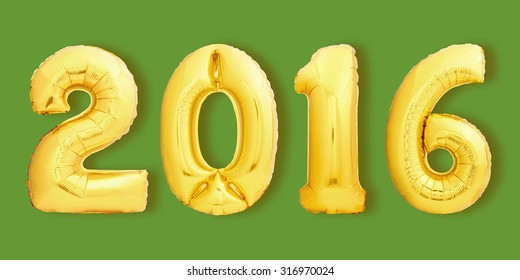 Golden Christmas 2016 sign made of inflatable balloons on green background.