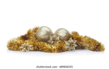 Golden Christmas arrangement against white background. Christmas balls, golden garland, flowers and spangles. Useful for banners