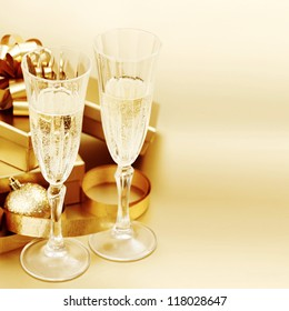 golden christmas background champagne gifts ball