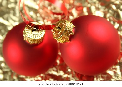 Golden Christmas background with red balloons and decorations