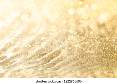 Golden Christmas background with sparkling and twinkling bokeh from party lights and golden glitter, full frame copyspace for your seasonal greeting