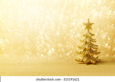Golden Christmas background with tree ornament