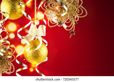 Golden christmas balls on a red background