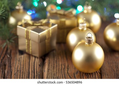 Golden Christmas baubles and gift boxes