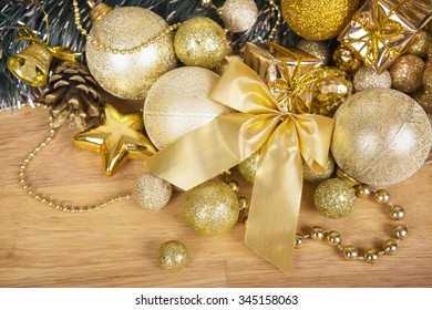Golden christmas bow on wooden surface with blur for background or greeting card.