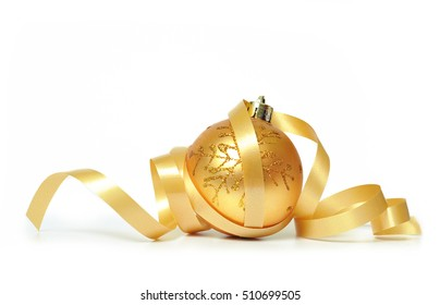 Golden christmas decoration with a ribbon isolated on white