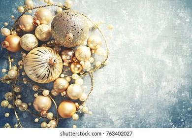 Golden Christmas Decorations on a Rustic Background