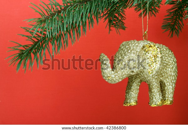 Golden Christmas elephant on red background