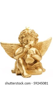 golden christmas figurine with trumpet on white background