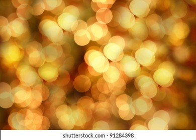 Golden Christmas lights at night. Beautiful blurred background.