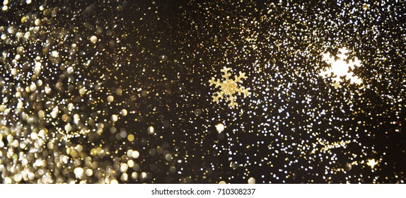 golden christmas new year glitter lights defocused background
