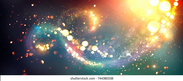 Golden Christmas and New Year glittering stars swirl bokeh background, backdrop with sparkling golden stars, holiday garland, magic glowing dust, lights. Vintage Gold Abstract Glitter Blinking sparks