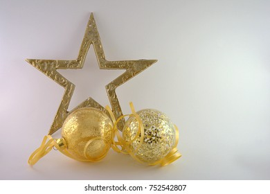 Golden Christmas ornament isolated, gift on light colour background