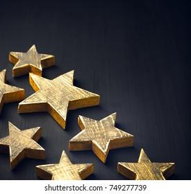 Golden Christmas Stars  Rustic on a dark background, Copyspace, handmade