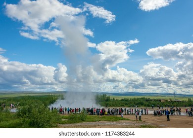 GOLDEN CIRCLE, ICELAND - AUG. 1, 2018: Tourists enjoying Geysir and Strokkur geysers and the surronding area at the Geysir geothermal Park on the Golden circle in Iceland