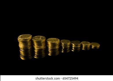 golden coin on black ground