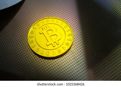 golden coin on silicon wafer, bitcoin symbolic medal, virtual currency that use cryptography for security.