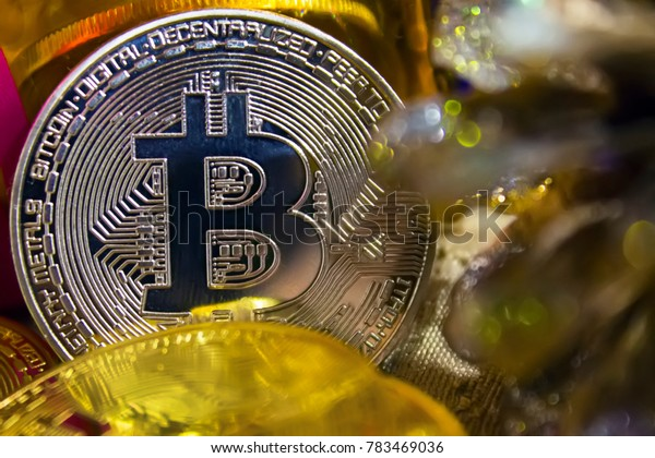 golden coins of bitcoins in the midst of New Year's gifts