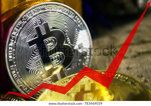golden coins of bitcoins, the red arrow of the graph is directed upwards