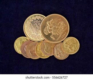 golden coins closeup on black velvet background