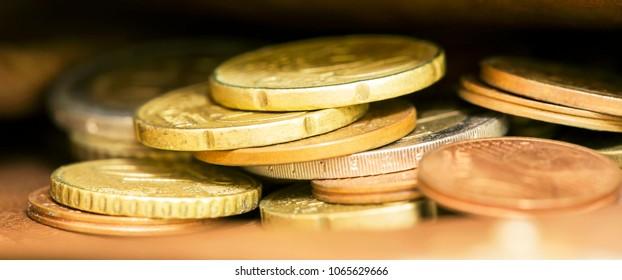 Golden coins closeup -  web banner of Euro money savings concept