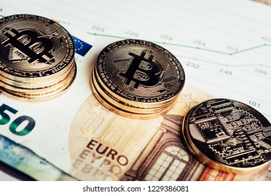 Golden  coins of crypto currency Bitcoin and Euro paper money