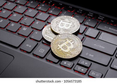 Golden Coins on a laptop keyboard. Cryptocurrency