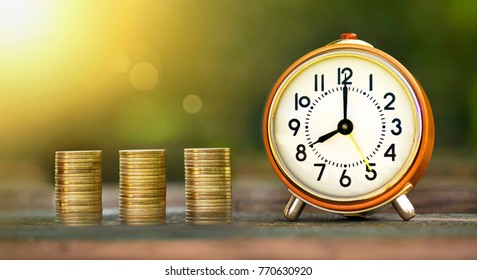 Golden coins and time - web banner of money savings concept