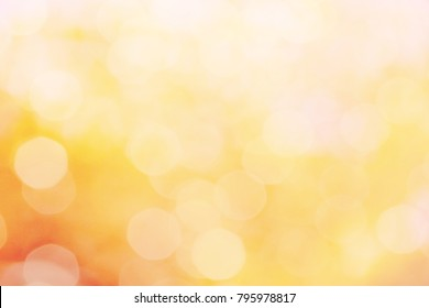 golden color abstract bacground withe blurred defocus bokeh light for template