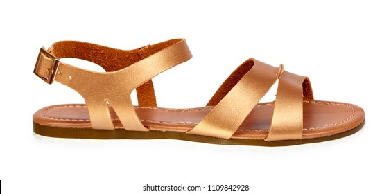 Golden color eco leather sandals isolated on white background.