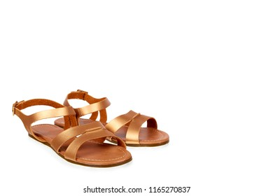 Golden color eco leather sandals isolated on white background, copy space template.